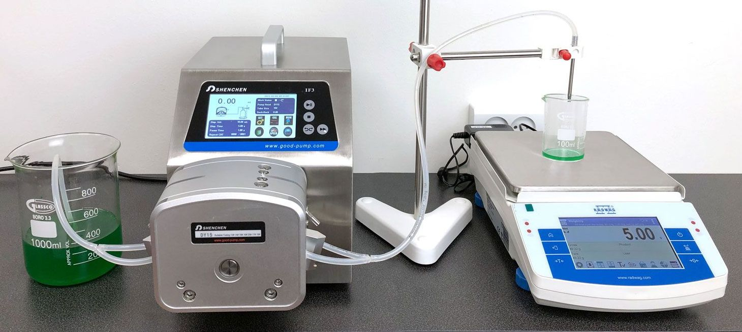 A precision balance together with a peristaltic pump